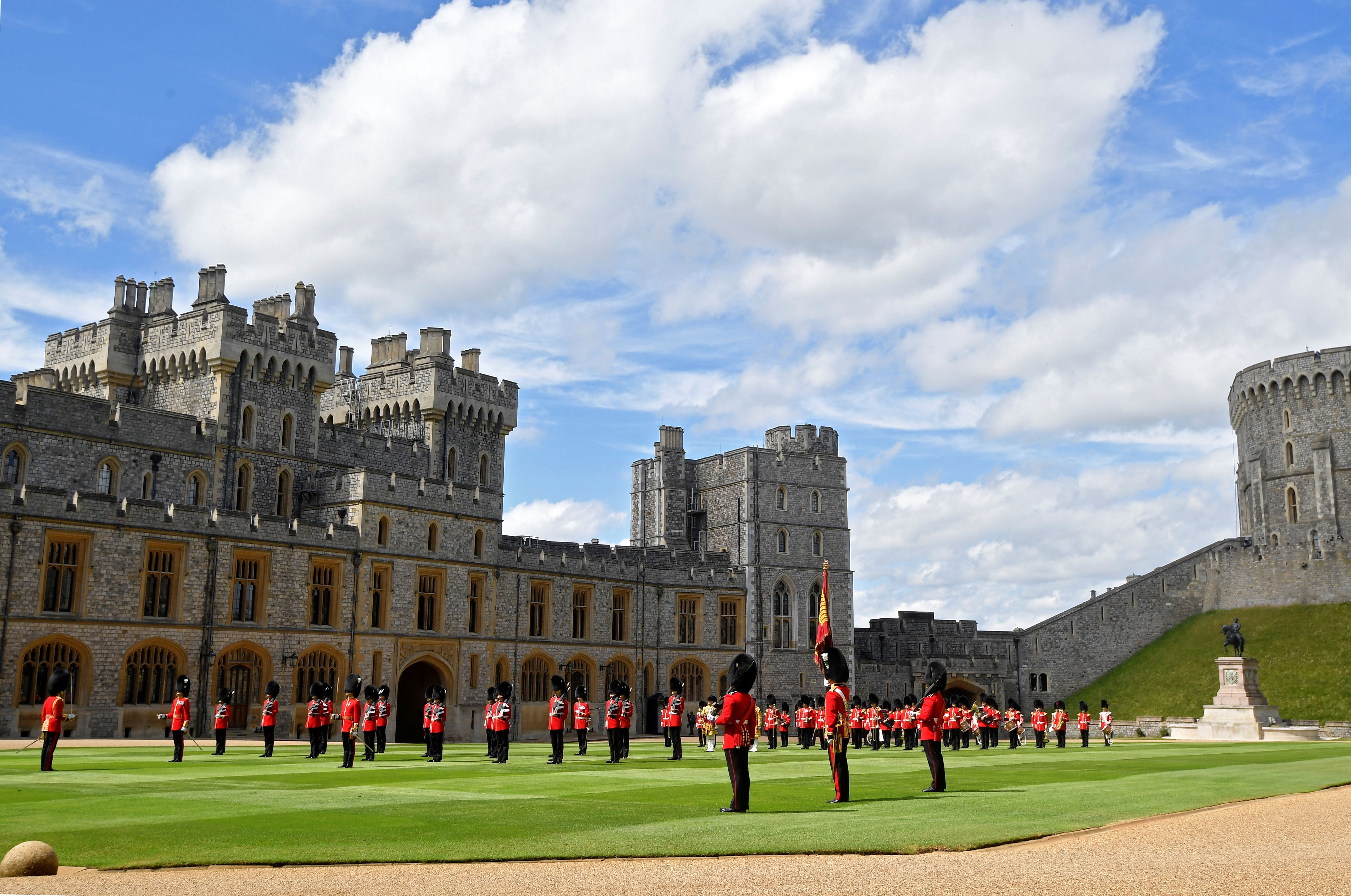 Guardsmen keeping social distance as they stand in formation during Trooping the Colour at Windsor Castle in Windsor, England | Photo: Toby Melville - WPA Pool/Getty Images
