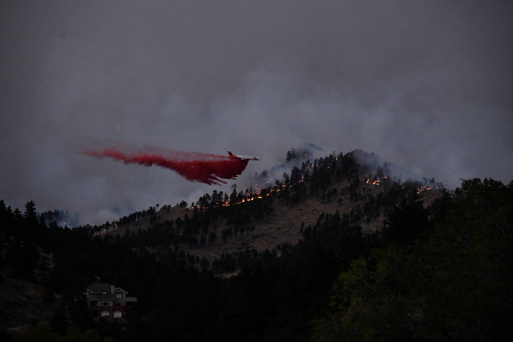 A slurry bomber drops retardant over the CalWood fire near Buckingham Park northwest of Boulder on Saturday October 17, 2020. | Photo: Getty Images