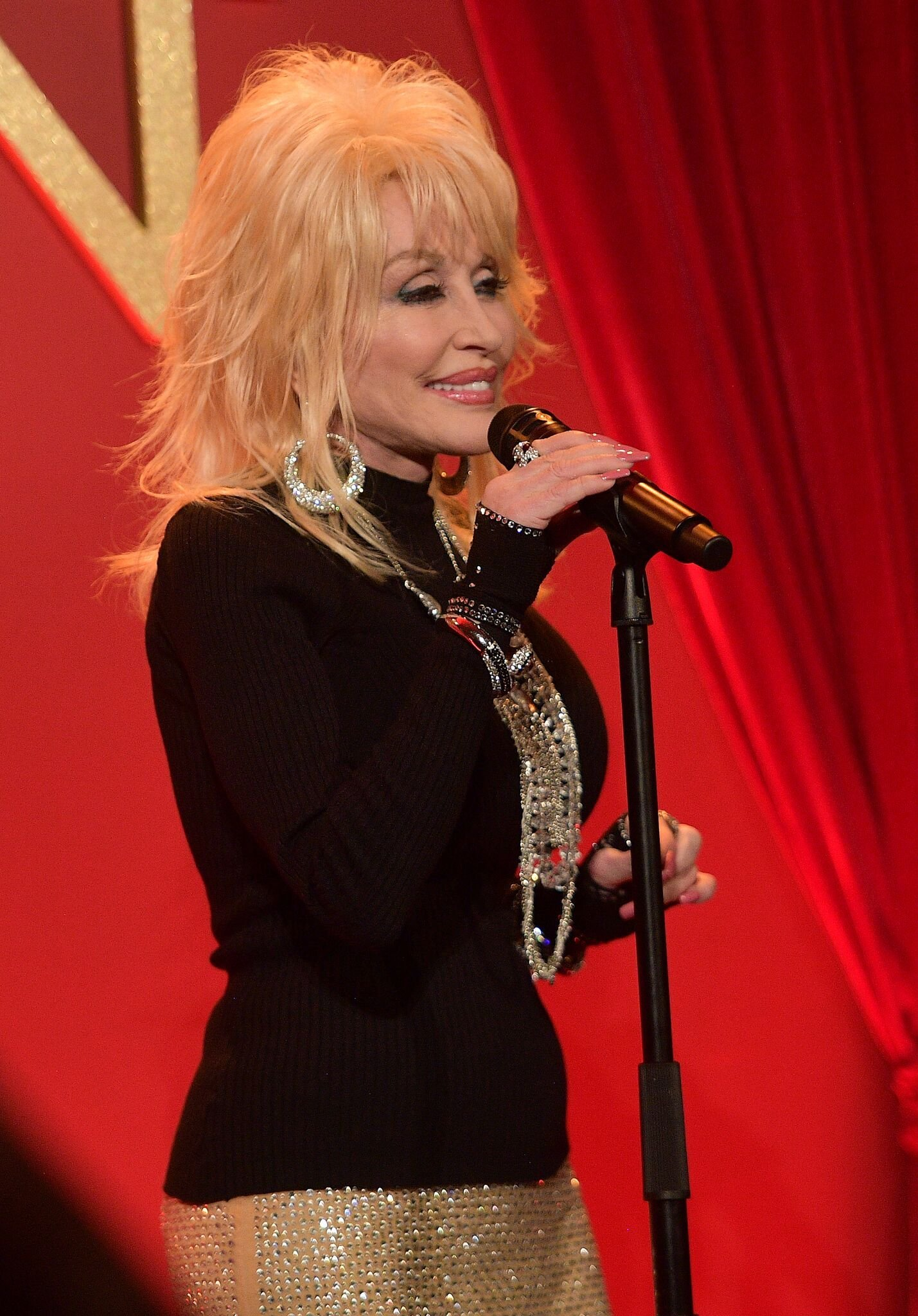 Dolly Parton performs onstage at a luncheon for the Netflix Film Dumplin' at Four Seasons Hotel Los Angeles | Getty Images