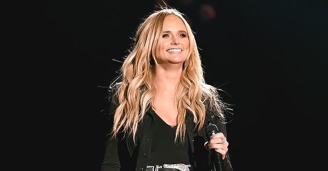 Miranda Lambert Shows off Flawless Beauty as She Poses in a Chic Top & Blue Jeans