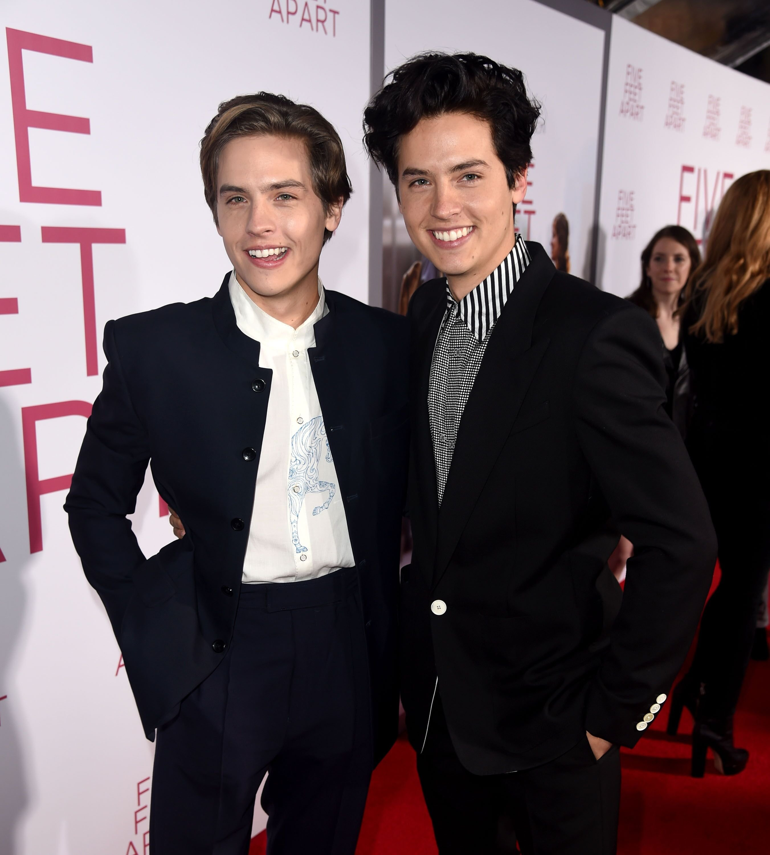 "Dylan Sprouse (L) and Cole Sprouse arrive at the premiere of CBS Films' ""Five Feet Apart"" at the Fox Bruin Theatre. 