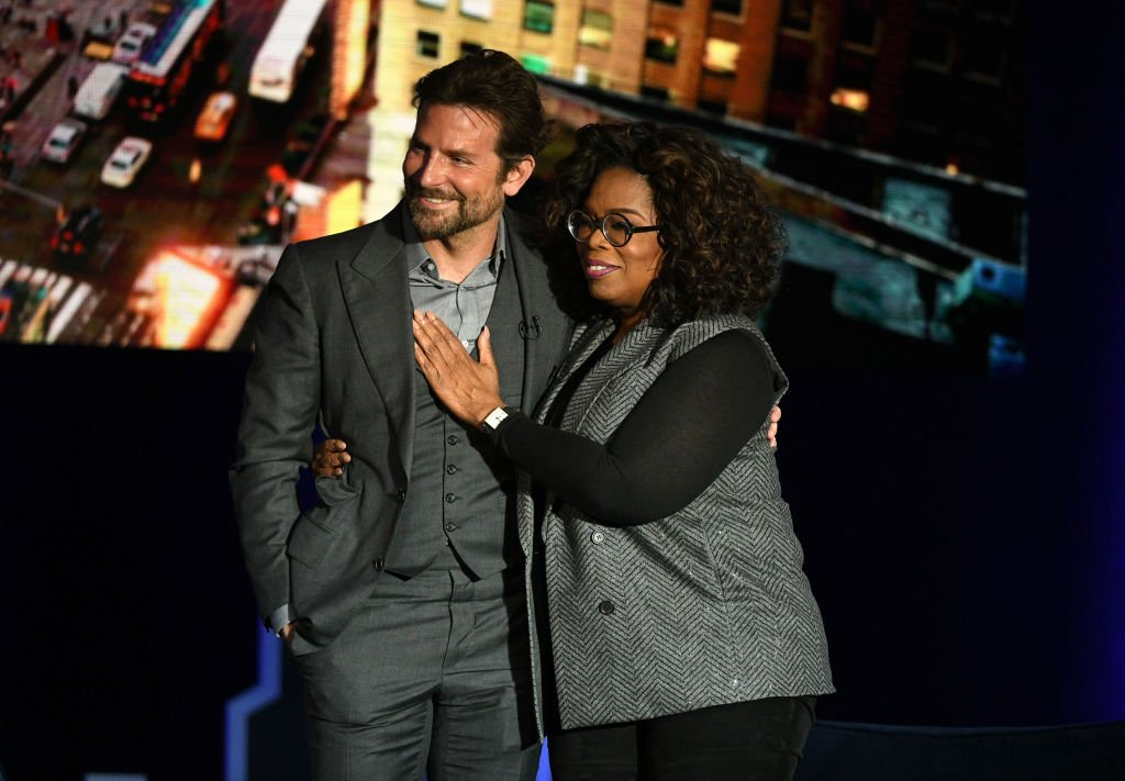 Bradley Cooper and Oprah Winfrey speak onstage during Oprah's SuperSoul Conversations at PlayStation Theater | Photo: Getty Images