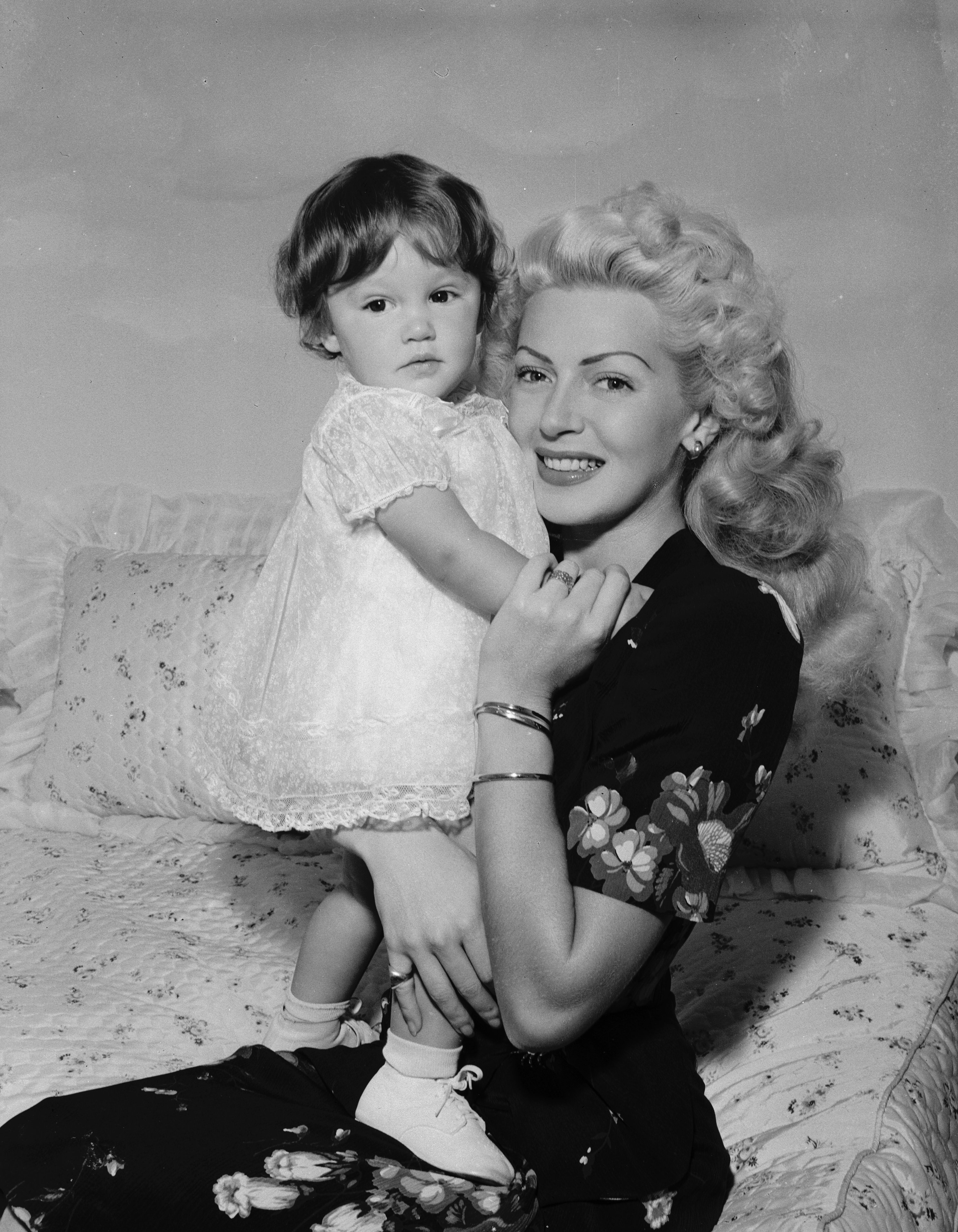 Hollywood actress Lana Turner (1920 - 1995) with her daughter Cheryl Crane. 25th July 1944 | Source: Getty Images