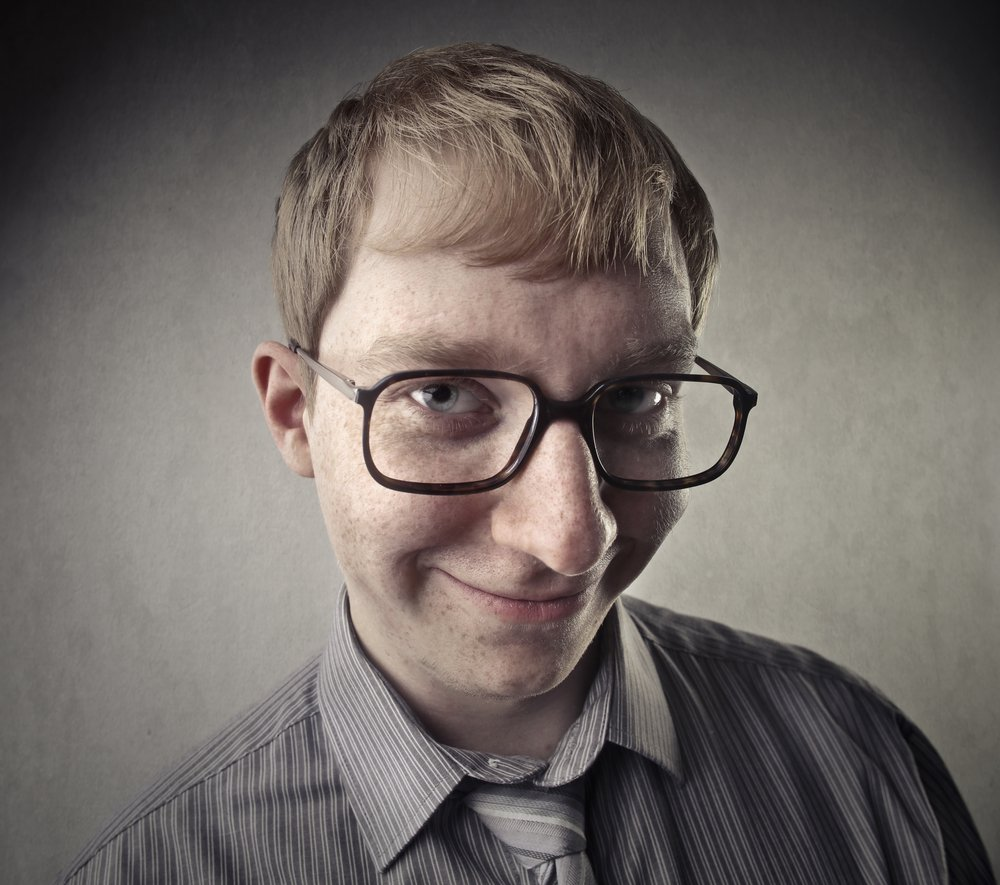 A man with glasses smiling | Photo: Shutterstock