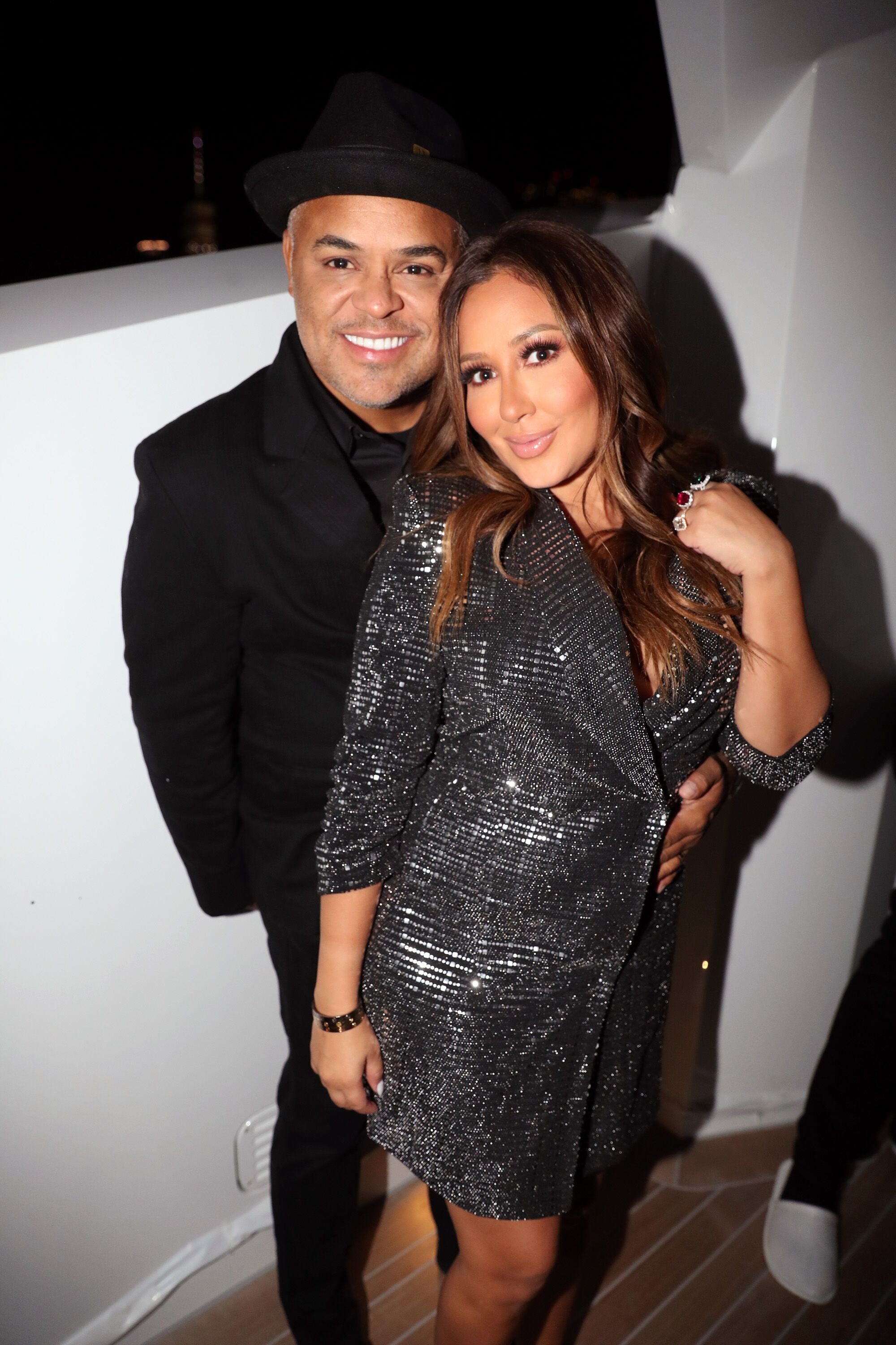 Israel Houghton (L) and Adrienne Bailon attend the Lumiere De Vie Hommes Launch Event. | Source: Getty Images