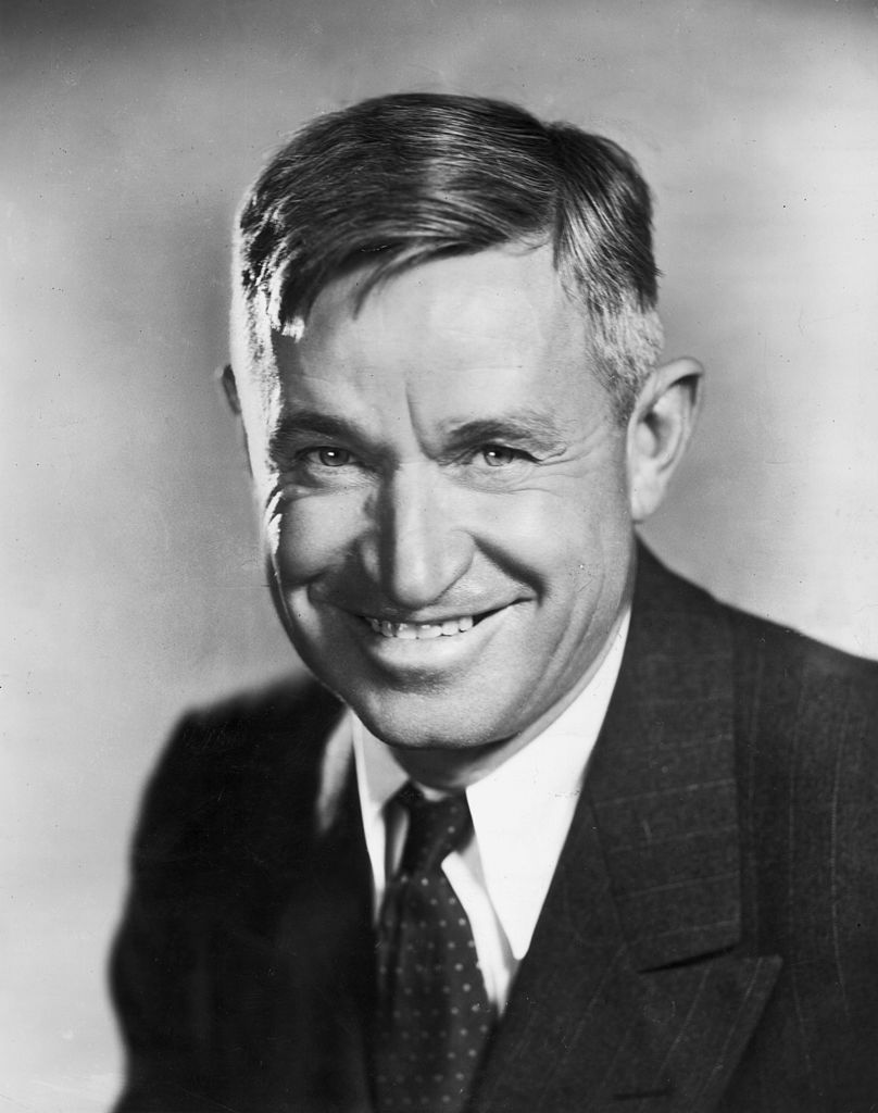 Studio portrait of American humorist and actor Will Rogers (1879 - 1935) smiling in a jacket and tie | Photo: Getty Images