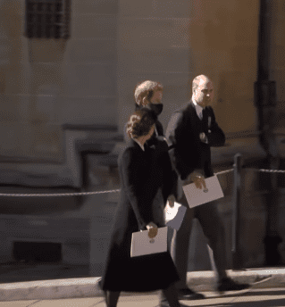 Kate Middleton, Prince Harry, and Prince William pictured walking together after Prince Philip's funeral, 2021, London, England. | Photo: Youtube.com/The Royal Family Channel