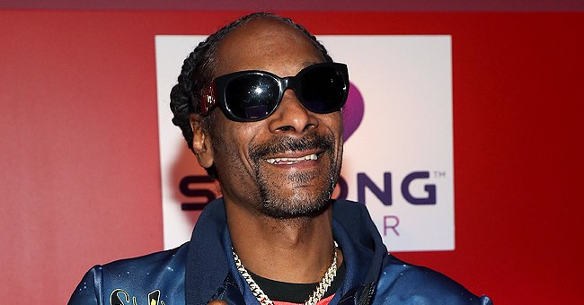 Snoop Dogg's Daughter Poses in a One-Sleeved Top & Matching Pants as She Flaunts Her Tattoos