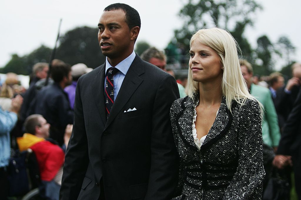 Tiger Woods and his wife Elin look on during the Opening Ceremony of the 2006 Ryder Cup. | Source: Getty Images