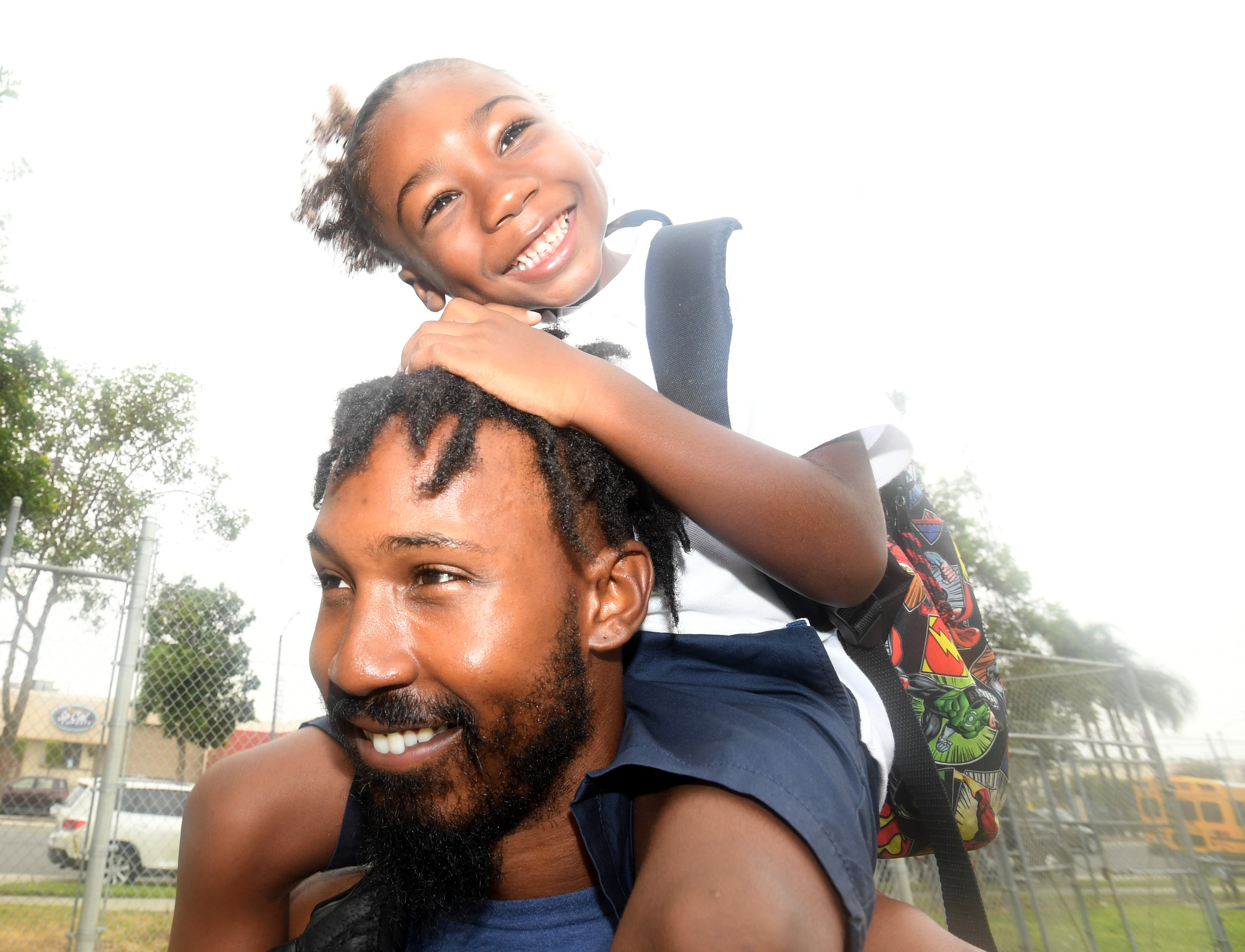 Kal-El Mulkey-Hiriams is all smiles on his dads shoulders and ready for the first day of kindergarten at McKinley Elementary School in Long Beach on Wednesday, August 28, 2019.|Photo: Getty Images