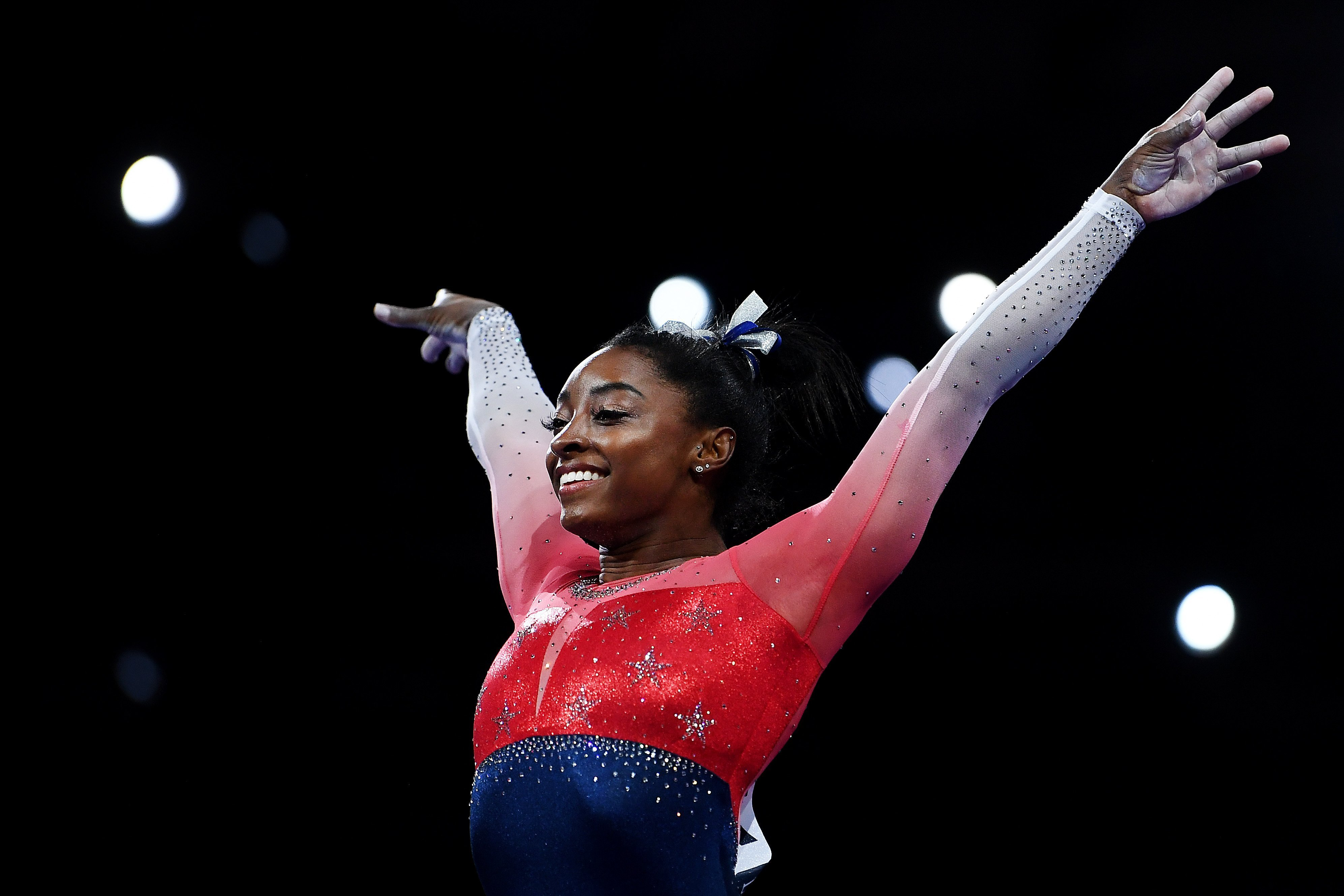 Simone Biles perfroming on the vault during day 5 of the FIG Artistic Gymnastics World Championships in Germany on October 8, 2019. | Photo: Getty Images