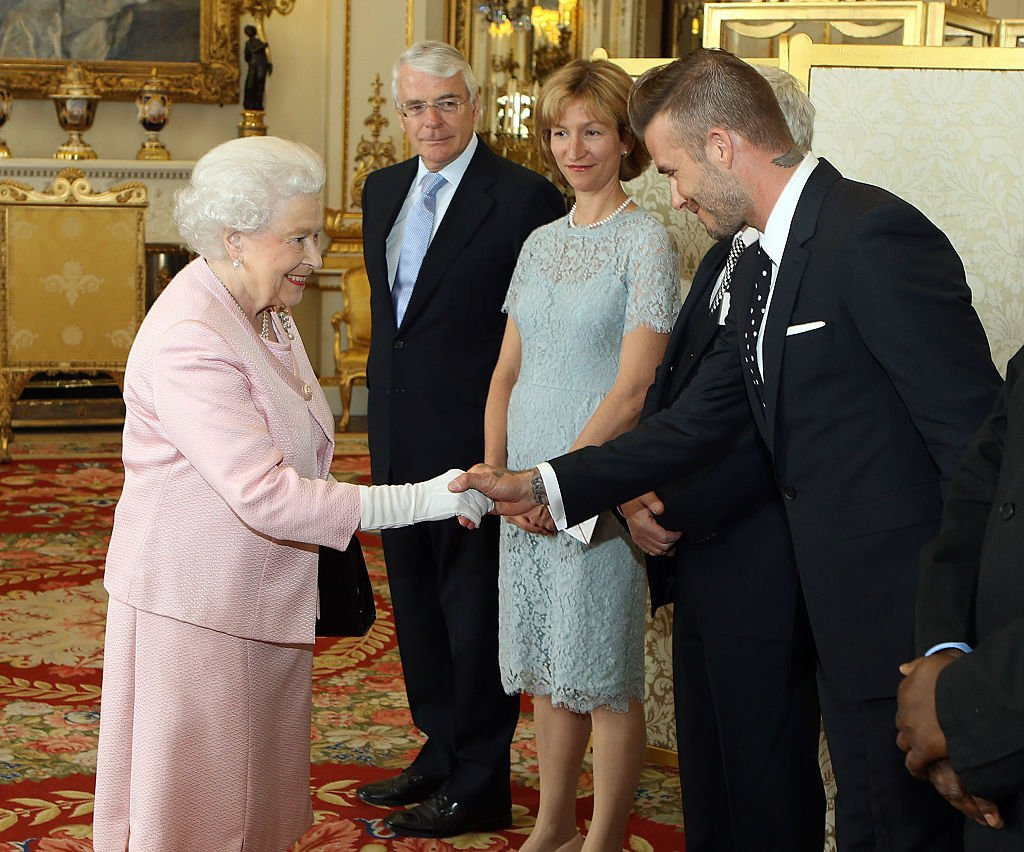 Queen Elizabeth II met David Beckham at a reception at Buckingham Palace, in London in 2015.   Source: Getty Images