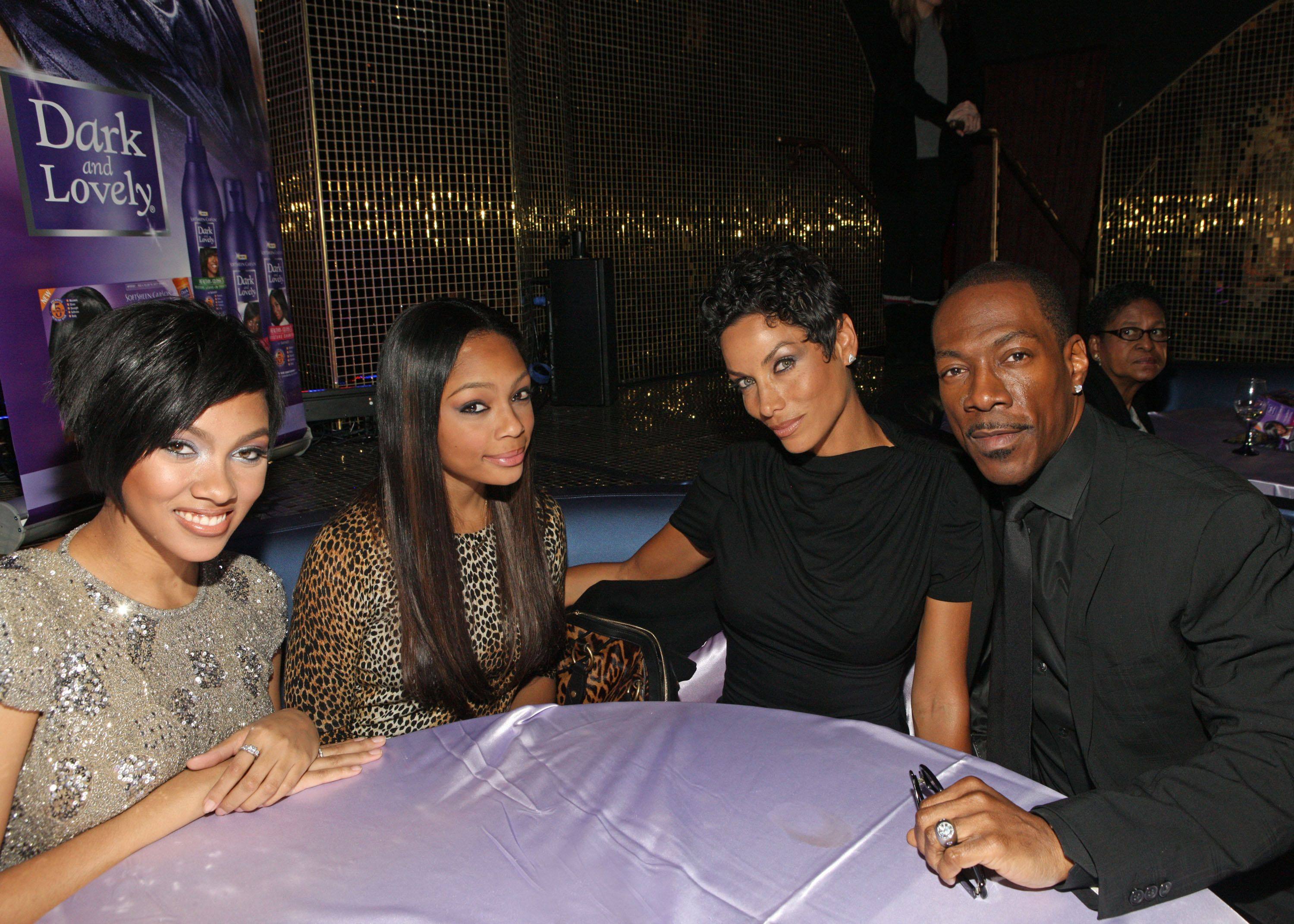 Bria, Shayne, Nicole Murphy, and Eddie Murphy at the SoftSheen-Carson Dark and Lovely event announcing Bria Murphy as New Global Brand Ambassador in 2011 in New York | Source: Getty Images