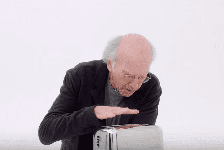"Larry David checks if the toaster is working during the promo of the tenth season of ""Curb Your Enthusiasm."" 