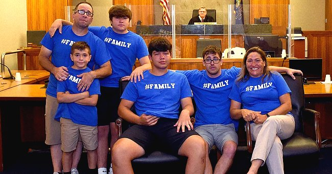 A photo of Nate and his new family is taken in court after the process was made official | Photo: Twitter/Beccah6abc