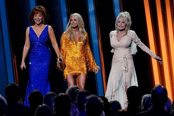 Reba McEntire, Carrie Underwood and Dolly Parton perform onstage during the 53rd annual CMA Awards at Bridgestone Arena in Nashville, Tennessee | Photo: Getty Images