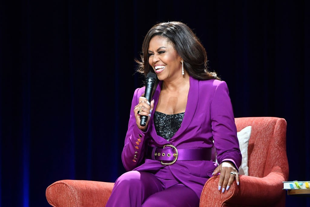 "Source: Getty Images / Michell Obama at ""Becoming: An Intimate Conversation with Michelle Obama"" book tour stop at the State Farm Arena, Atlanta on May 11, 2019"