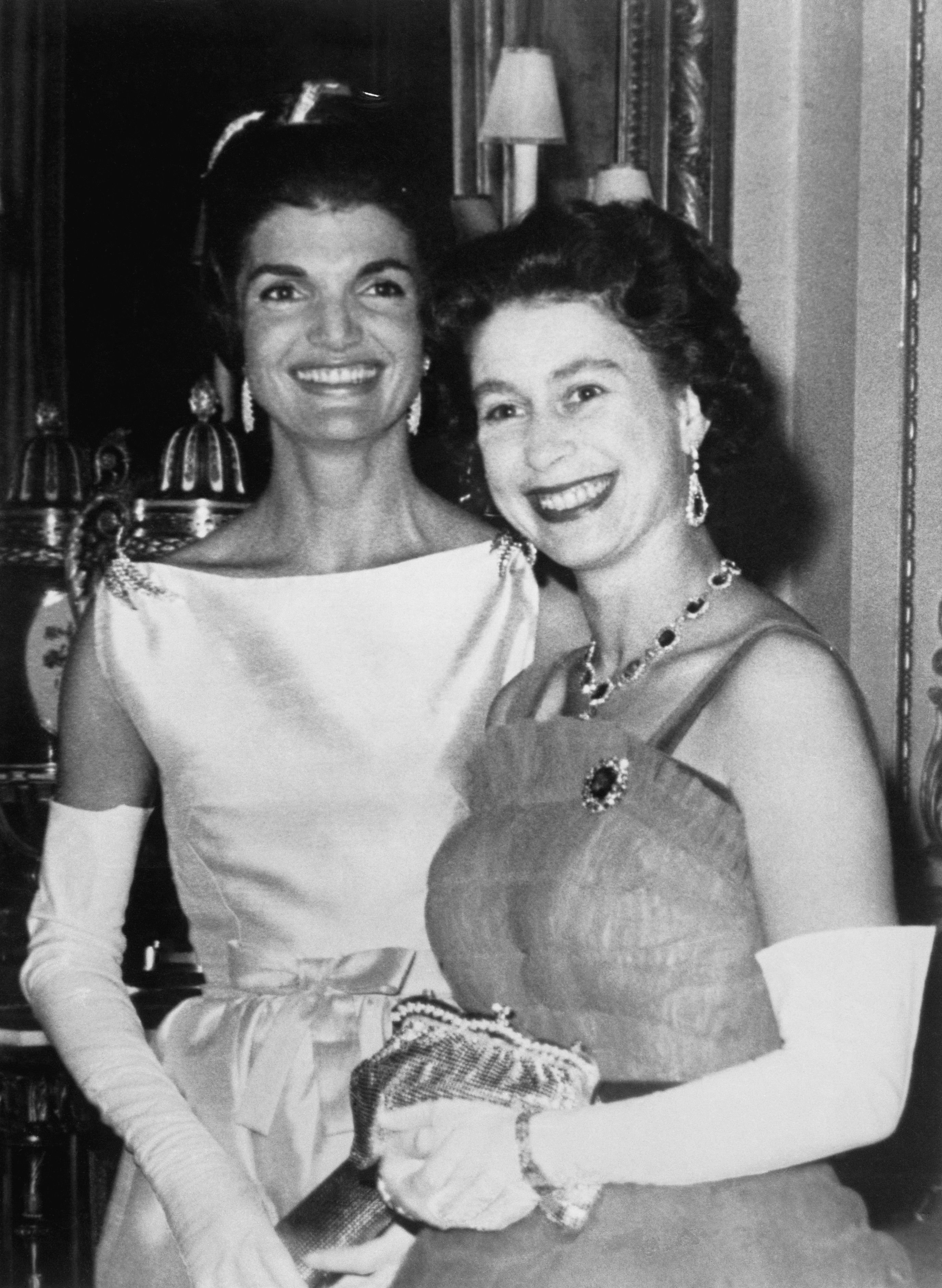 Queen Elizabeth and Jacqueline Kennedy after dinner at Buckingham Palace here June 5, 1918. | Source: Getty Images