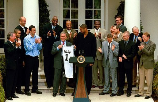Tim Duncan and the Spurs at the White House with President George Bush after winning the 2003 NBA Finals| Source: Wikimedia