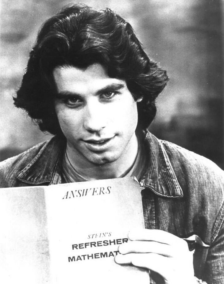John Travolta reading a books | Wikimedia Commons