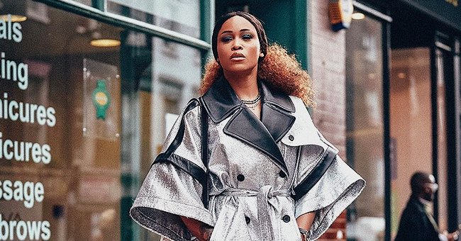 Eve from 'The Talk' Looks Regal as She Poses in Silver Wide-Sleeved Coat & Black Heels in New Photo