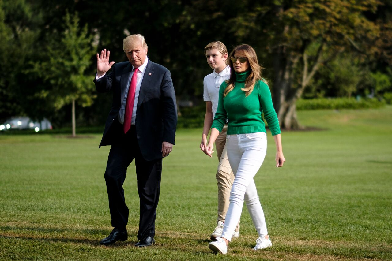 Donald Trump disembarks from Marine One on the South Lawn with First Lady Melania Trump and his son Barron. | Source: Getty Images