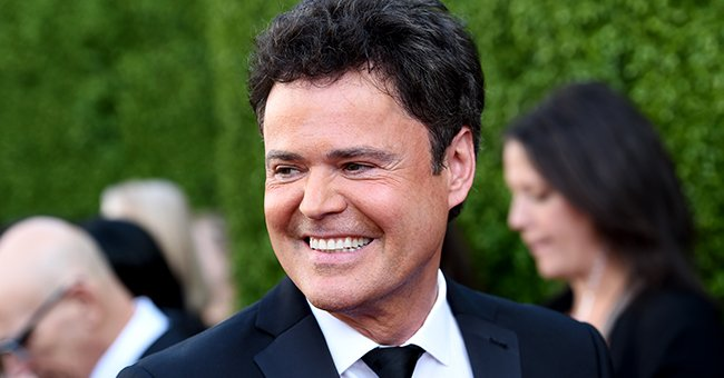Take a Look at This Sweet Throwback Pic of Donny Osmond Sharing a Kiss with Wife of 42 Years, Debbie