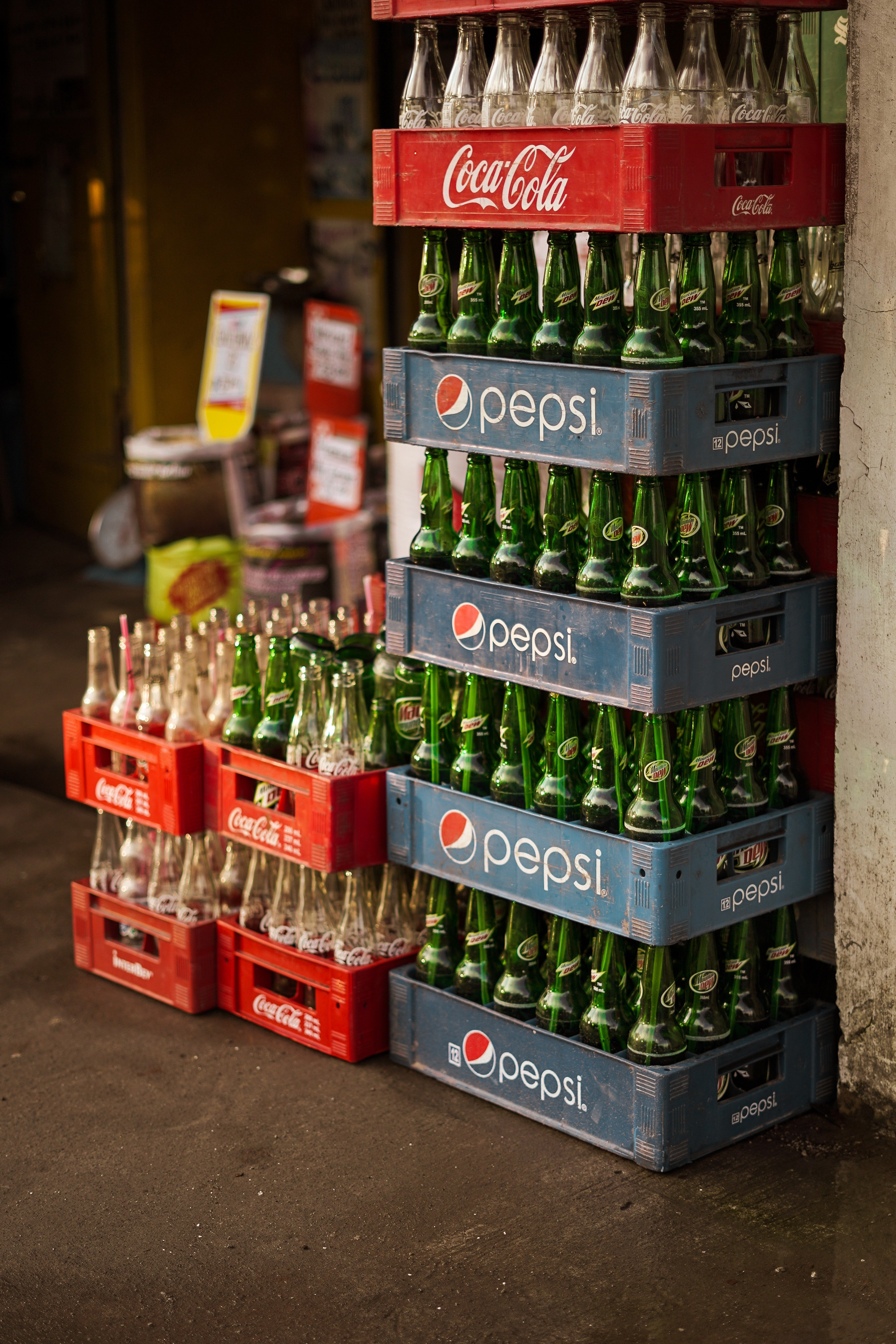 Soft drink bottles placed in racks inside a store. | Photo: Pexels