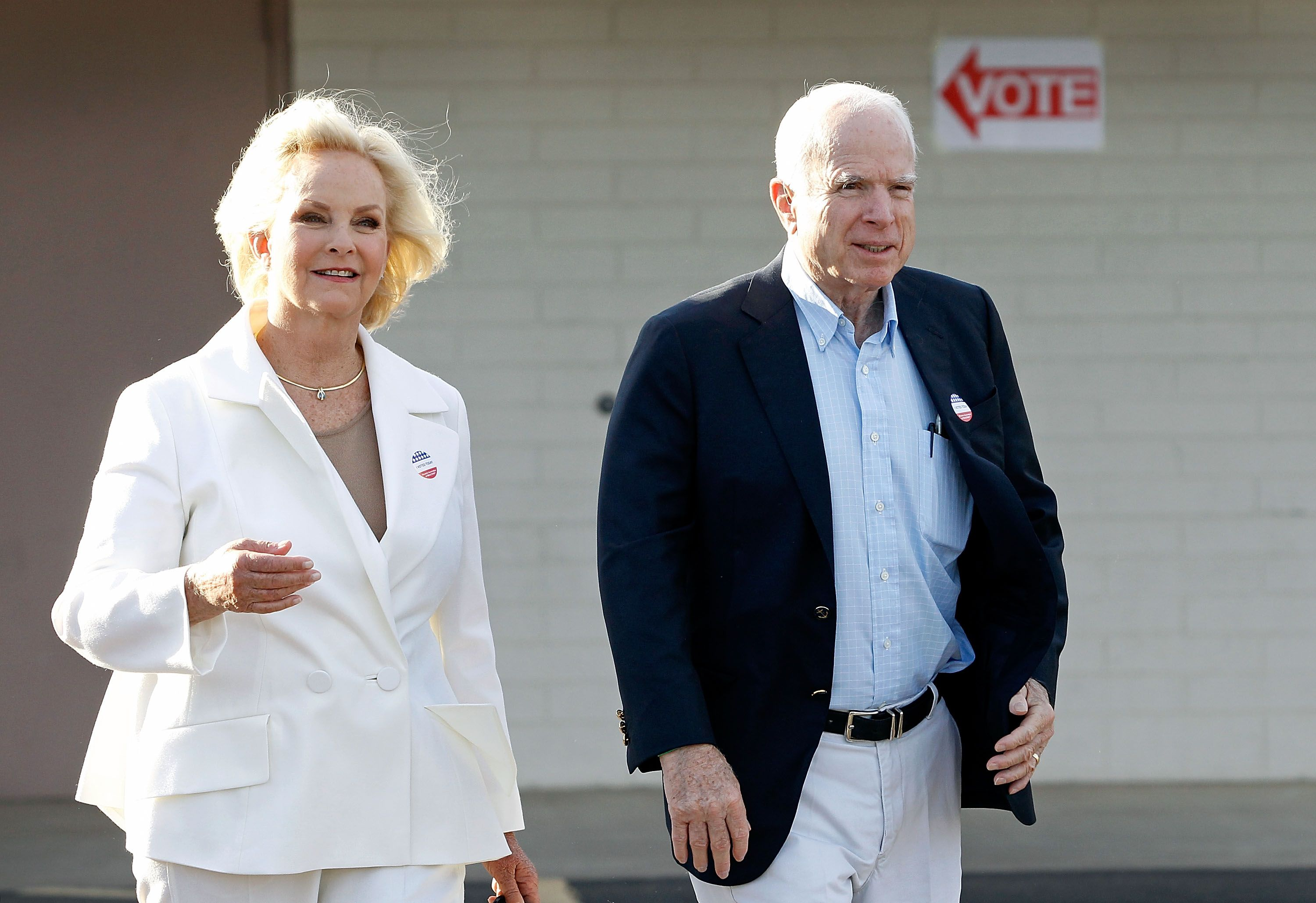 Sen. John McCain and Cindy McCain exit the Mountain View Christian Church polling place after casting their vote on November 8, 2016 | Getty Images