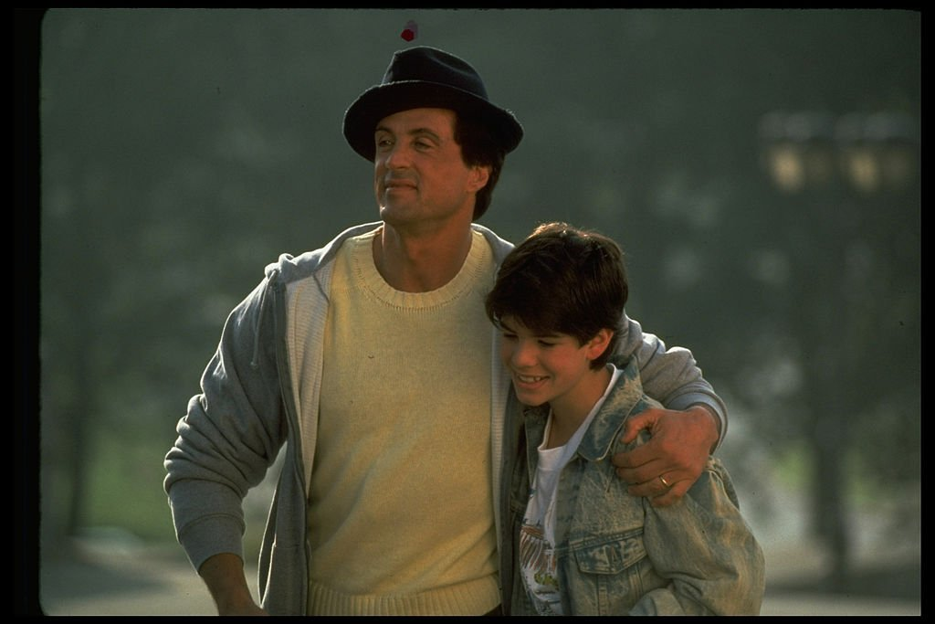 Actor Sylvester Stallone with his arm around his son, Sage, in scene from 1990 motion picture Rocky V | Photo: Getty Images
