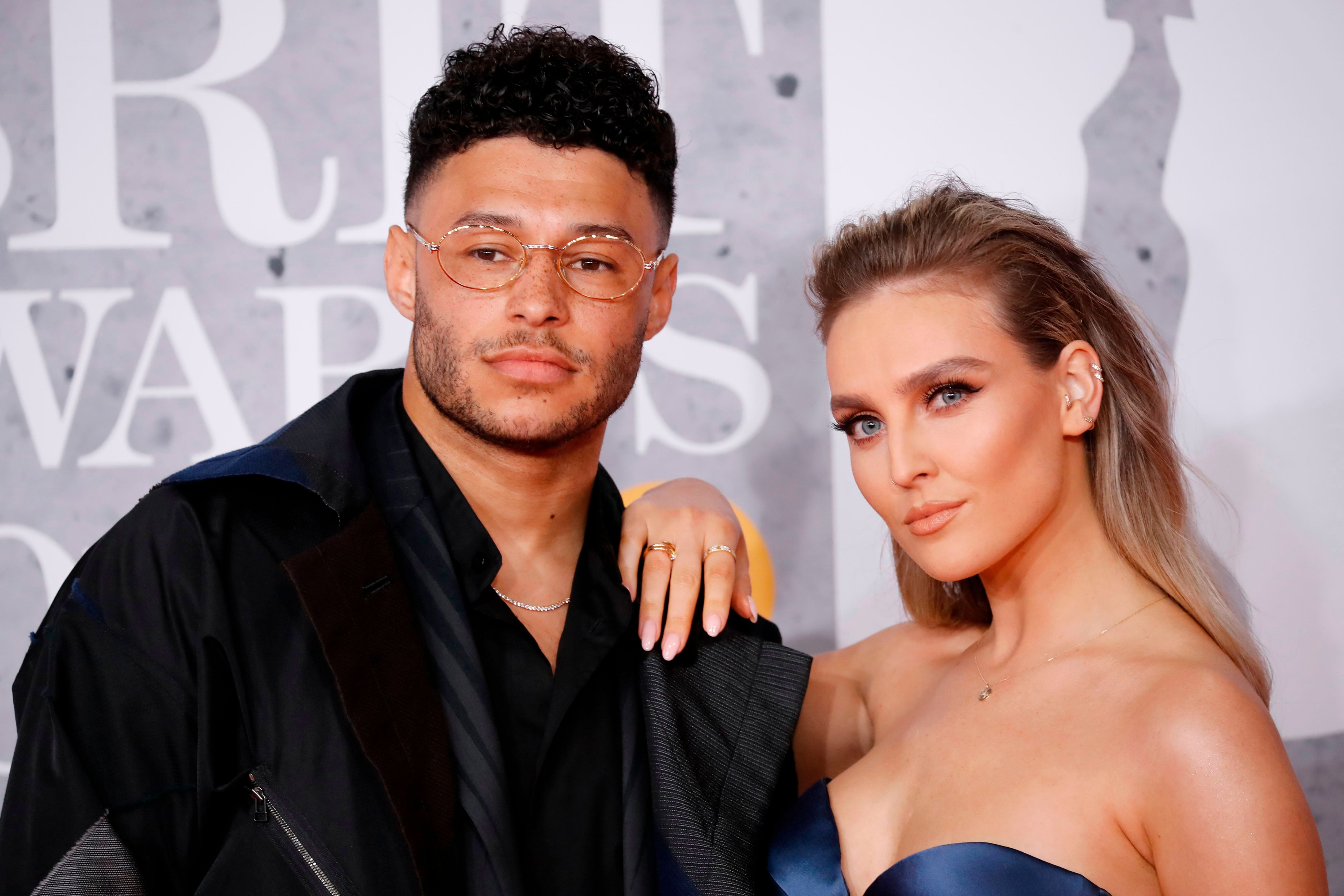 Alex Oxlade-Chamberlain and Perrie Edwards at the BRIT Awards in London on February 20, 2019 | Photo:Tolga Akmen/AFP/Getty Images