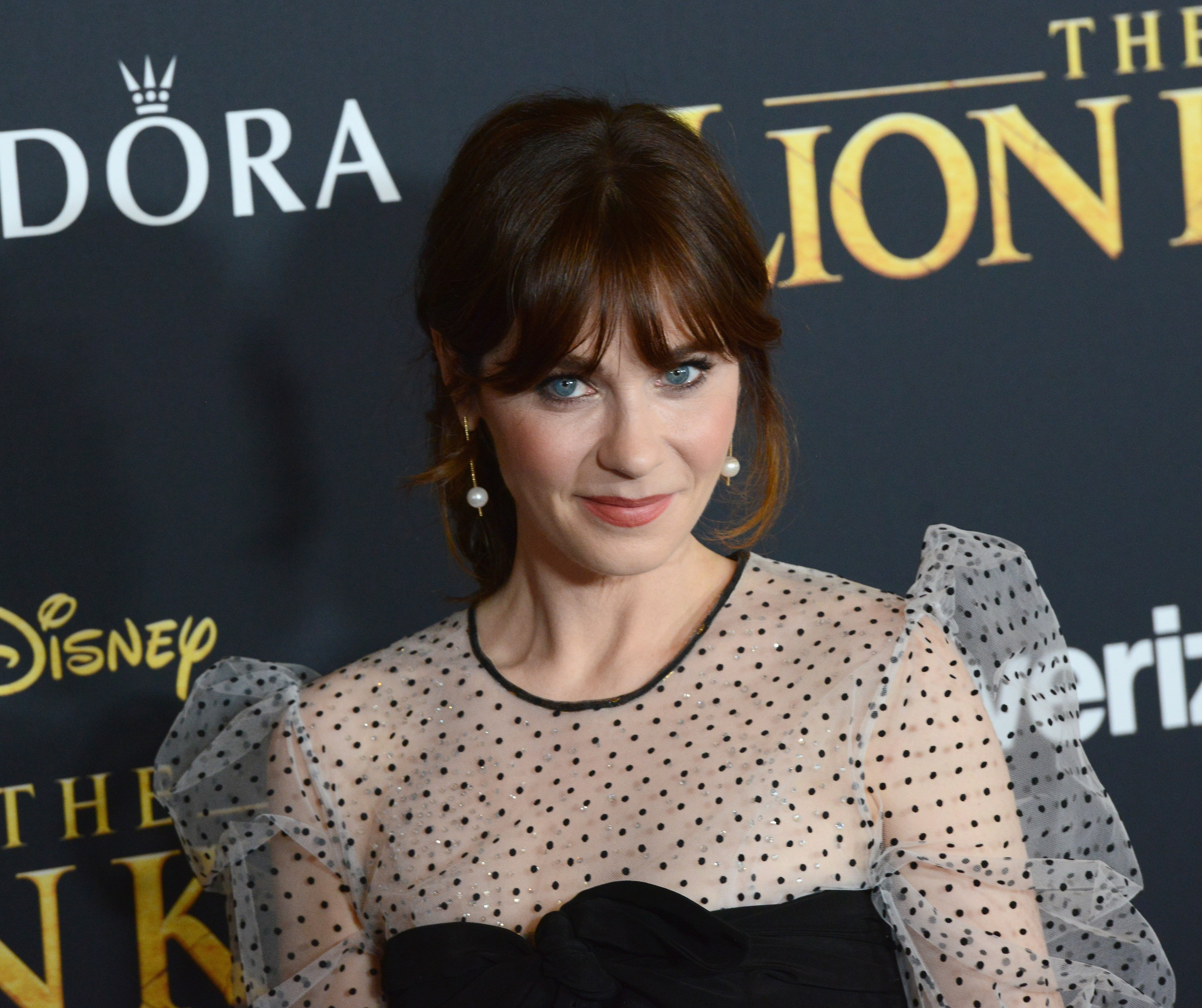 """Zooey Deschanel attends """"The Lion King"""" premiere at Dolby Theatre on July 9, 2019, in Hollywood, California. 