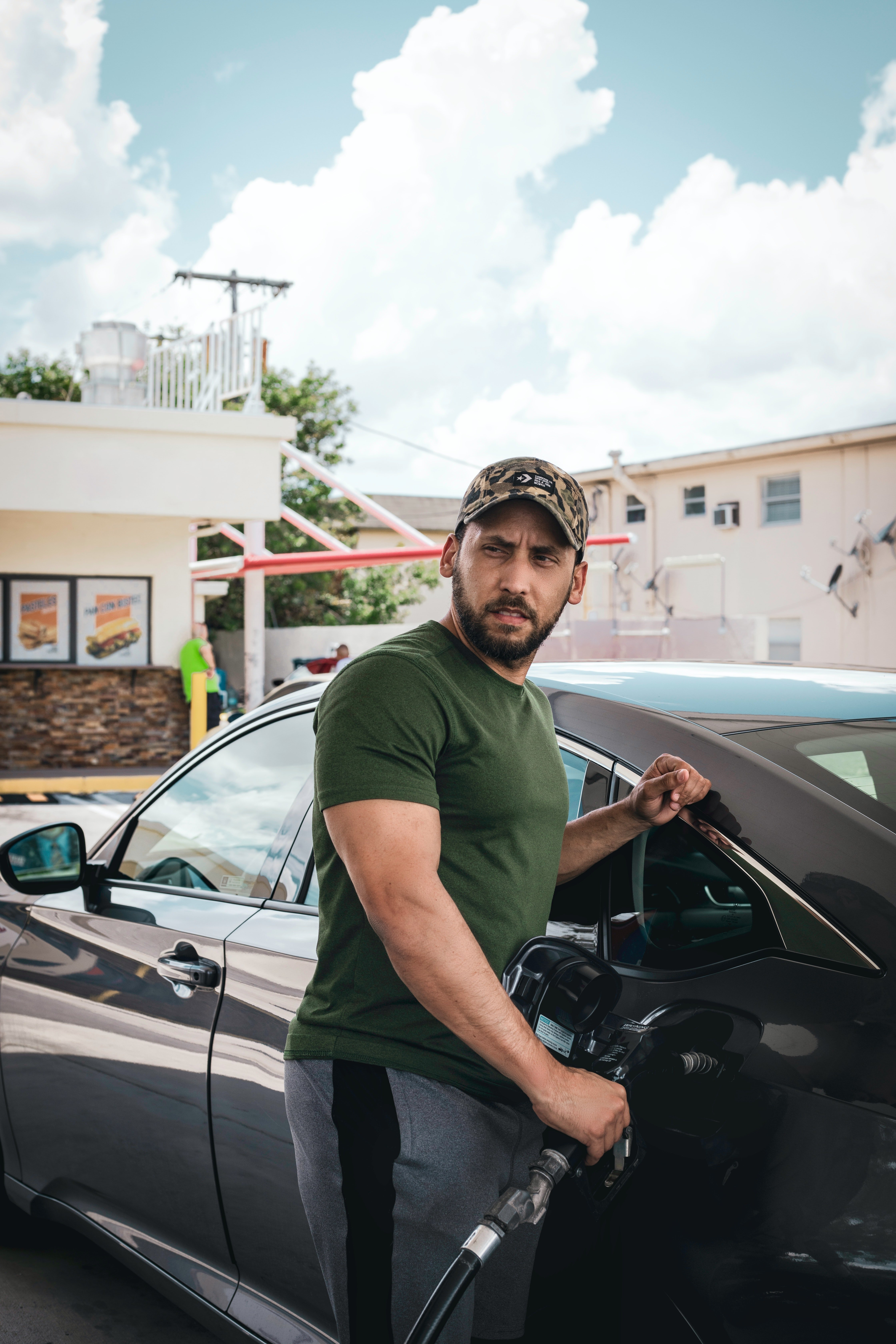 A man fills up his car with fuel at a gas station | Pexels/One Shot