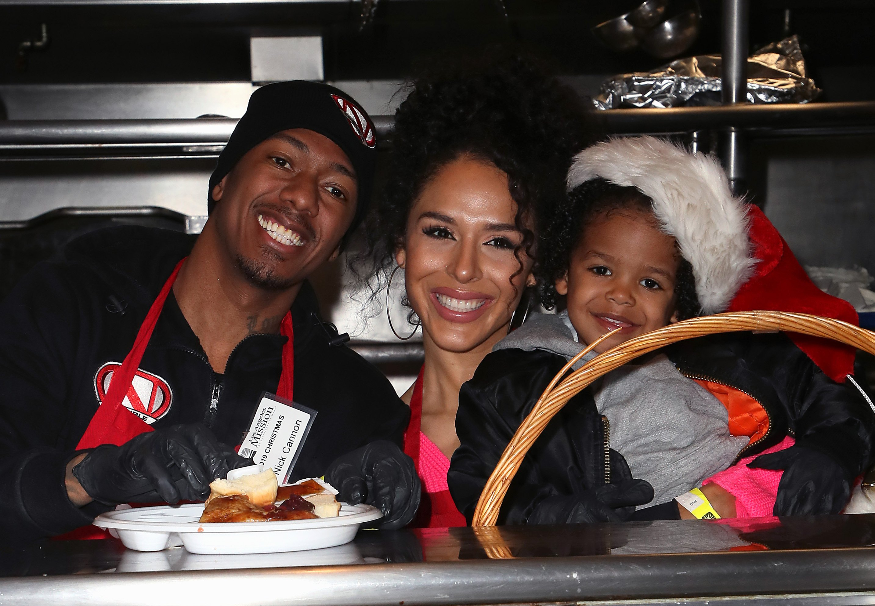 Nick Cannon, his girlfriend, Brittany Bell and their son Golden Cannon at the Christmas Celebration On Skid Row in Los Angeles, 2019   Source: Getty Images