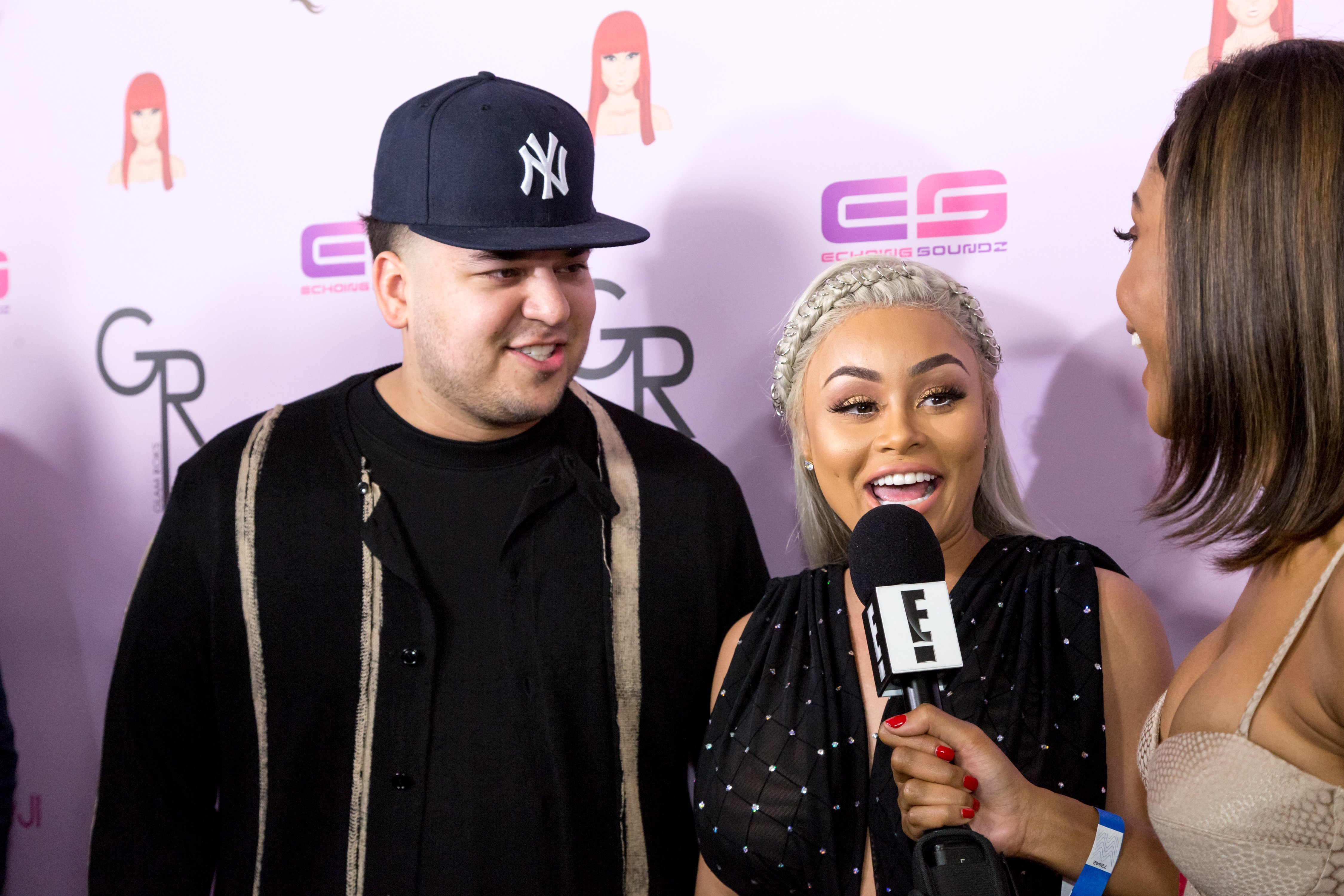 "Rob Kardashian & Blac Chyna at her birthday celebration and unveiling of her ""Chymoji"" emoji collection on May 10, 2016. 