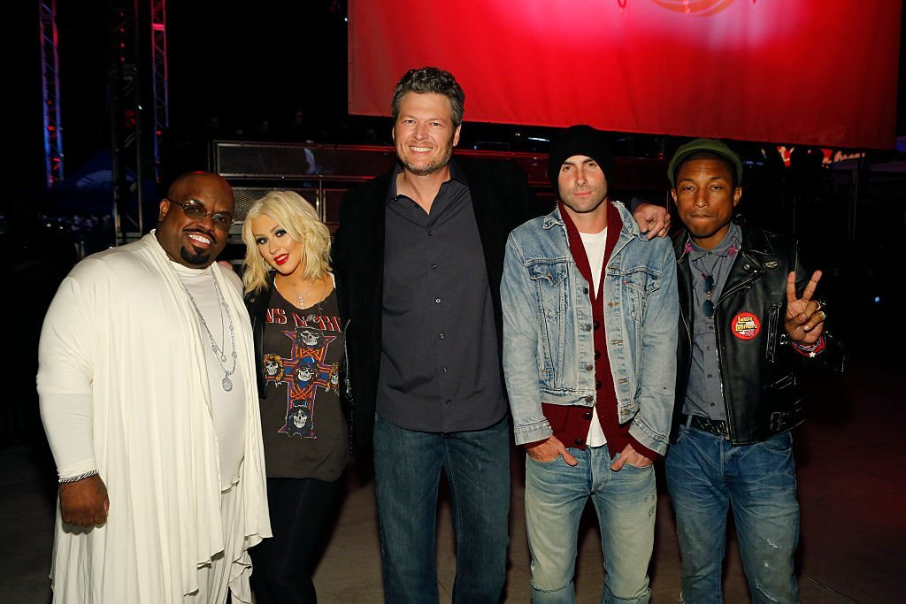 """Former and current """"The Voice"""" coaches CeeLo Green Christina Aguilera, Blake Shelton, Adam Levine and Pharrell William pose at a concert in West Hollywood, California on April 23, 2015 