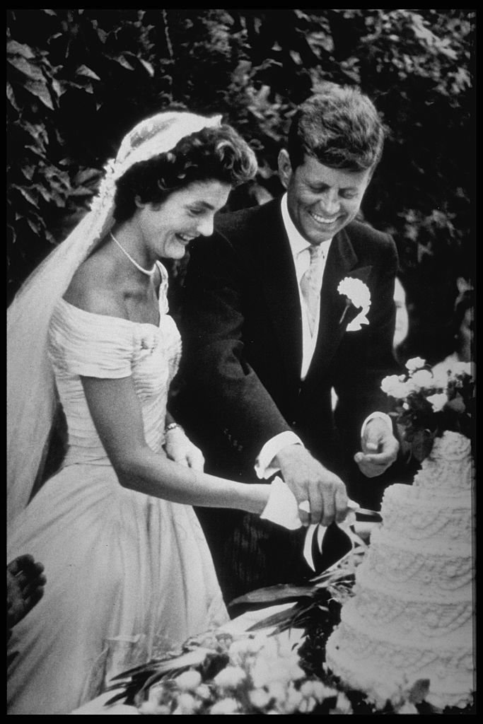 Jackie and John Kennedy cut their wedding cake in 1953   Source: Getty Images