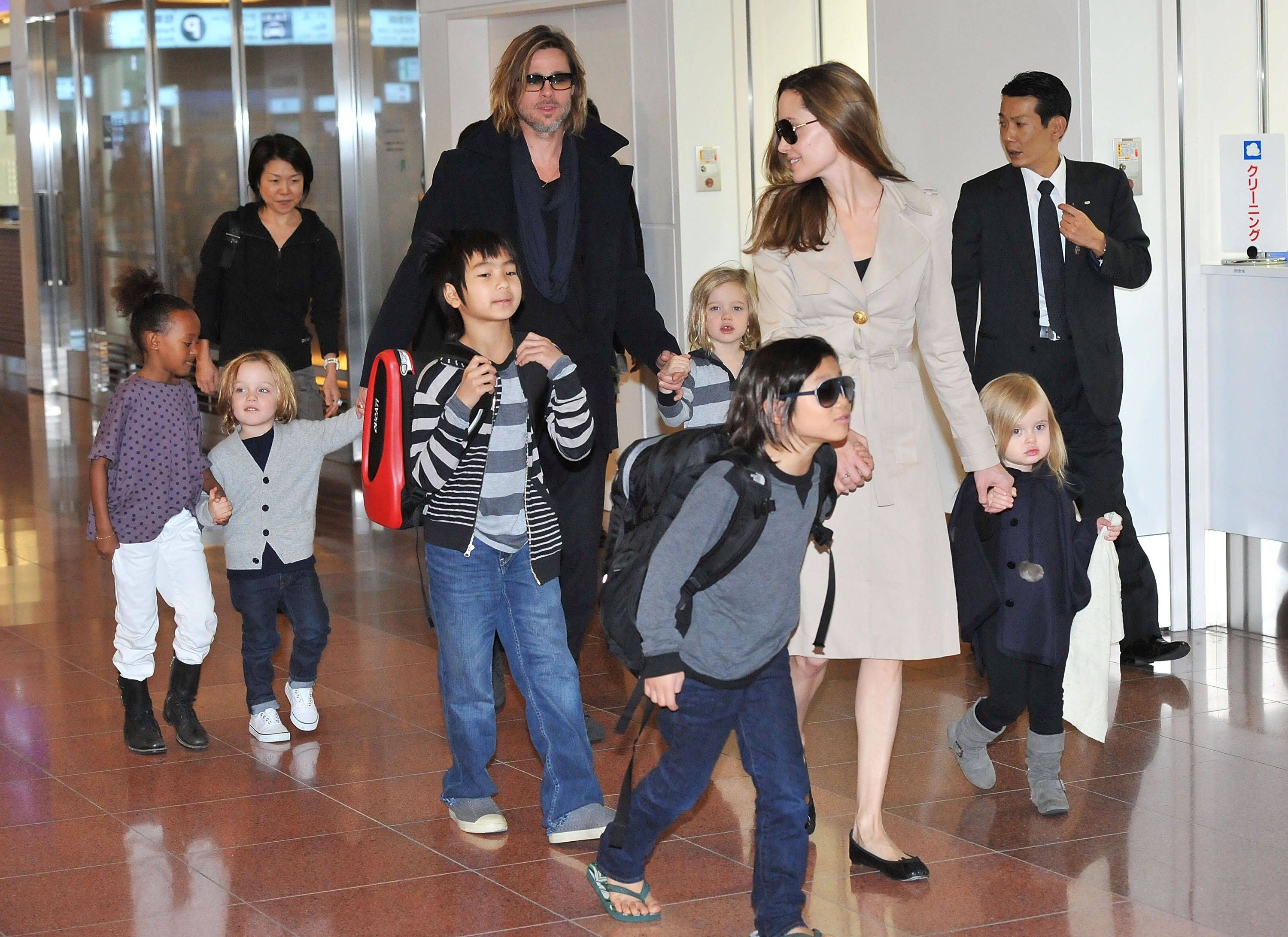 Brad Pitt, Angelina Jolie and their six children Maddox, Pax, Zahara, Shiloh, Knox, and Vivienne arrive at Haneda International Airport on November 8 in Tokyo, Japan on November 08, 2011. | Photo: Getty Images