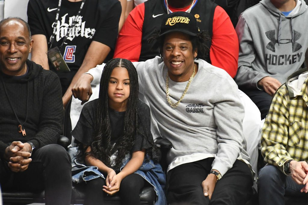 Rapper Jay-Z and daughter Blue Ivy Carter watching a basketball game at the Staples Center in Los Angeles in March 2020. | Photo: Getty Images
