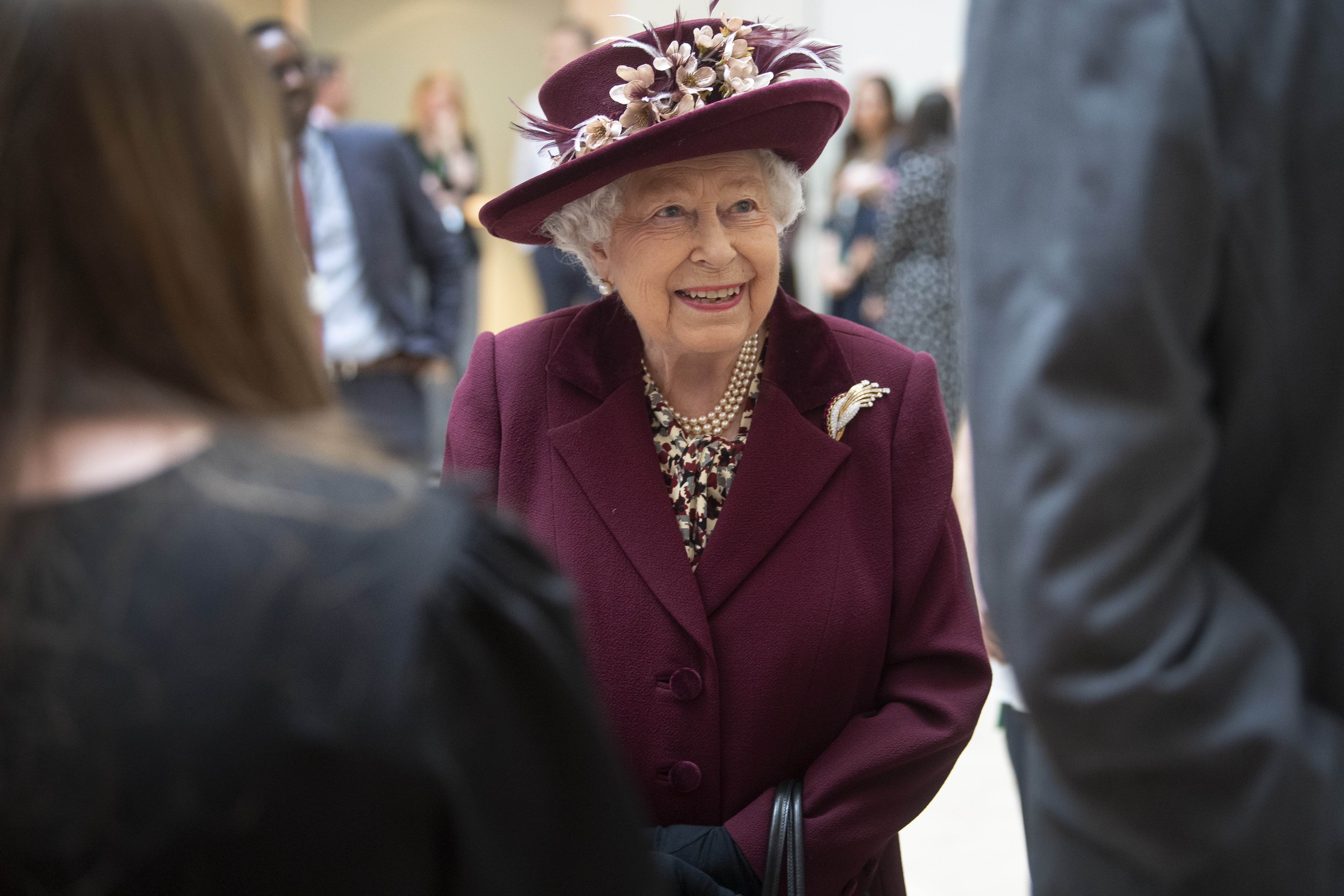 Queen Elizabeth II talks with MI5 officers during a visit to the headquarters of MI5 at Thames House on February 25, 2020, in London, England. | Source: Getty Images.