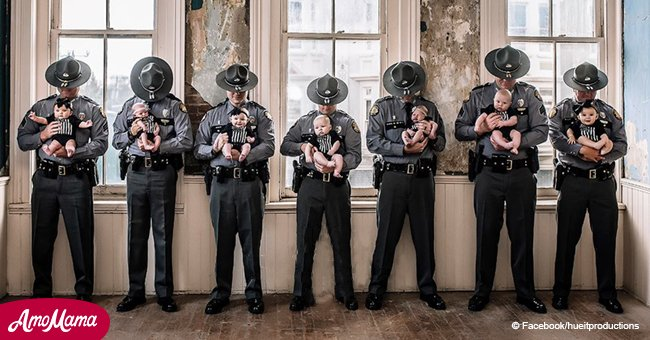 Viral photo of 7 American officers posing with their babies born within 6 months of each other