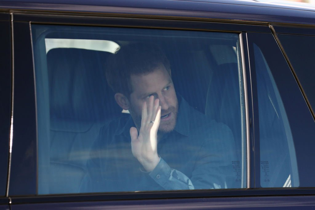 Prince Harry waves from his vehicle as he left the Silverstone Experience at Silverstone on March 6, 2020, in Northampton, England | Source: Simon Dawson-WPA Pool/Getty Images