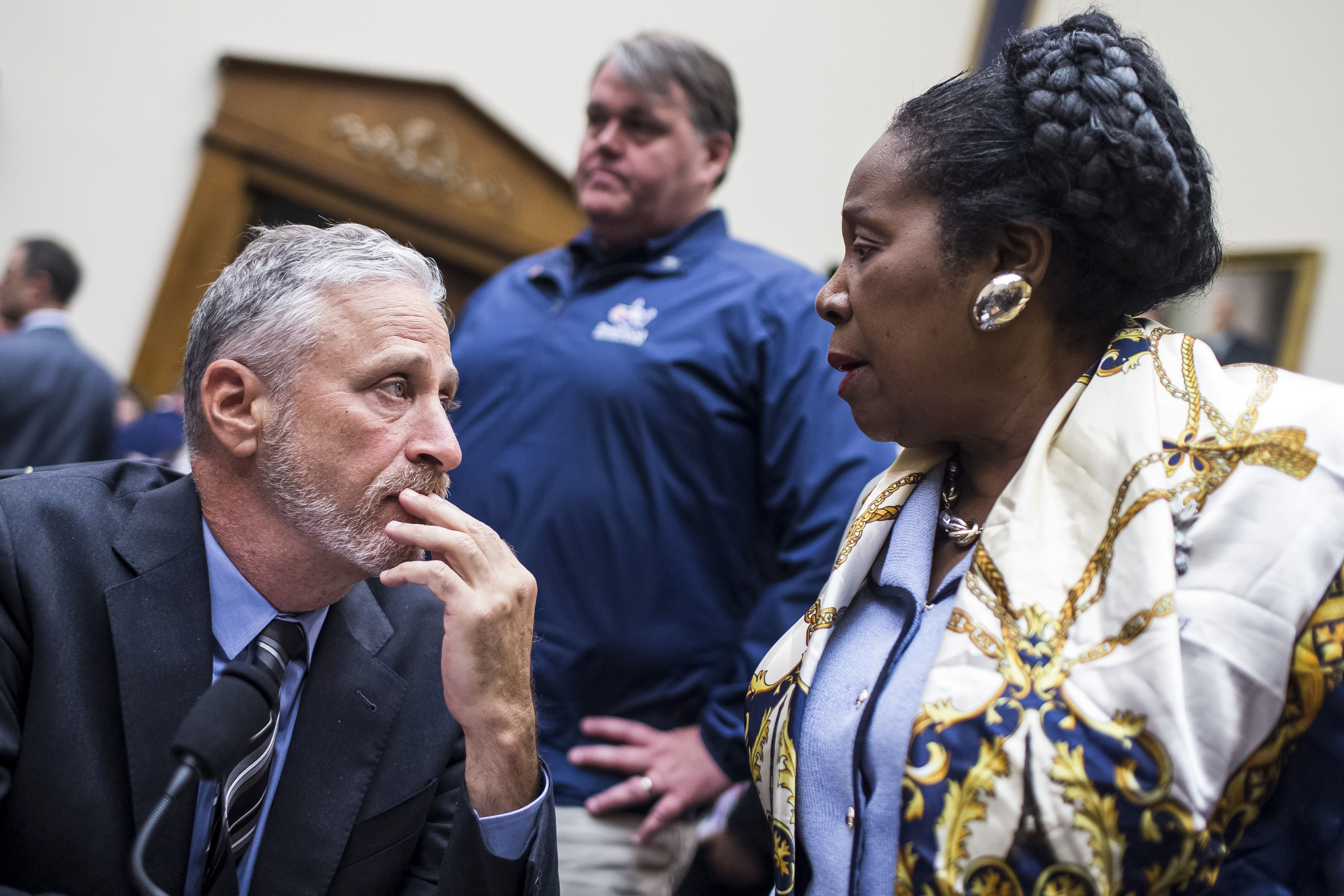 Jon Stewart speaks to Rep. Sheila Jackson Lee (D-TX) on Capitol Hill on June 11, 2019 in Washington, DC. | Source: Getty Images