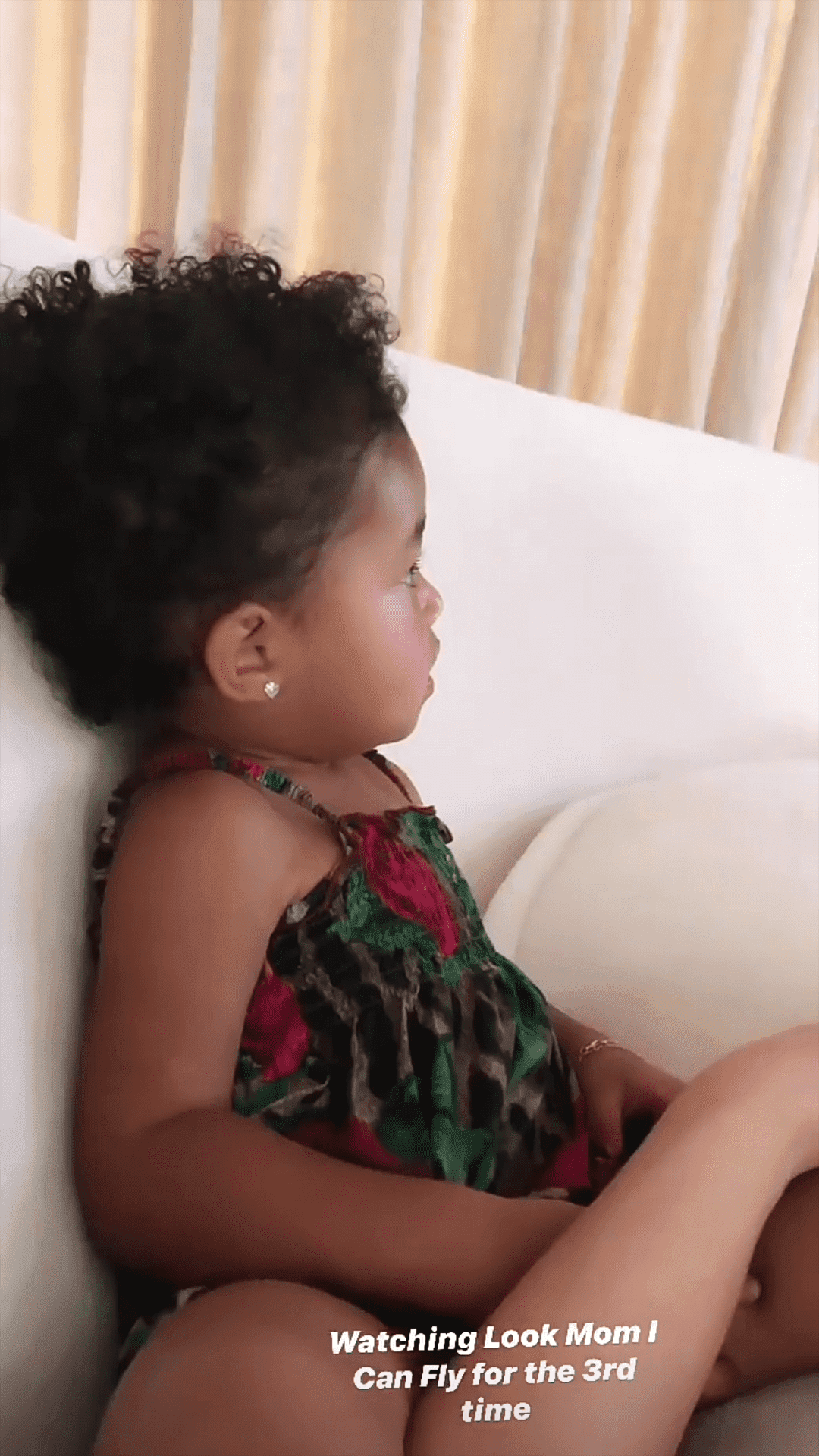 """A screenshot of Stormi Webster watching her dad's documentary, """"Look Mom I Can Fly"""" 