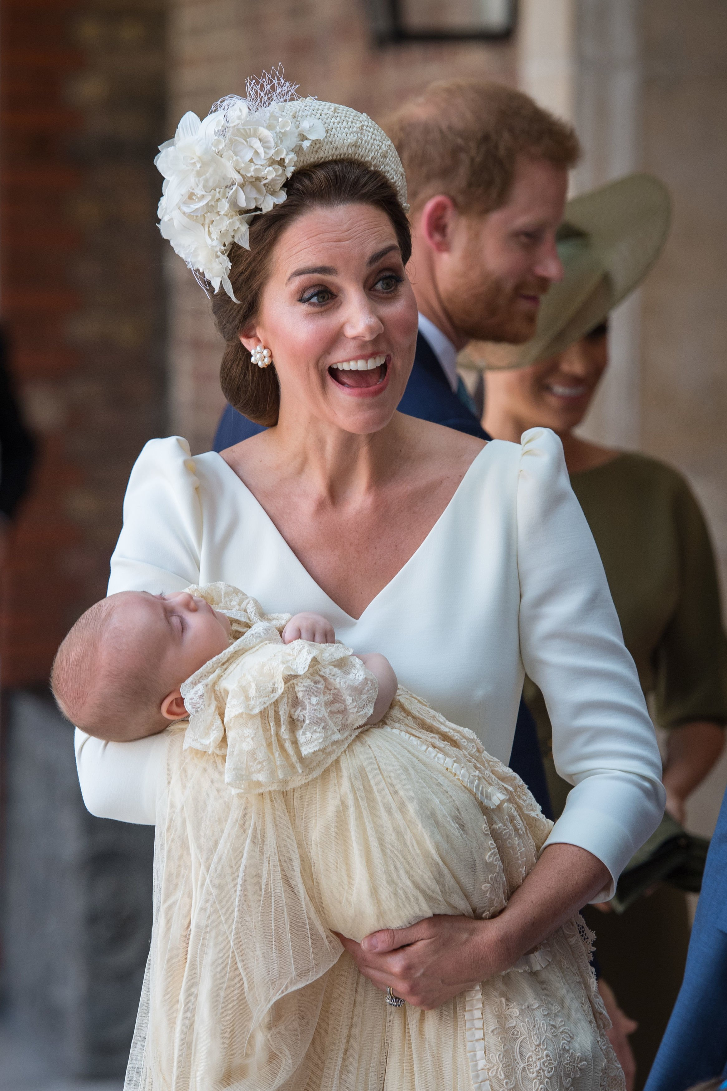 Prince Louis wearing the replica of the royal christening gown while being held by Kate Middleton at St James's Palace in London, England | Photo: Getty Images