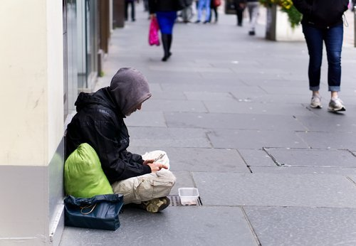 A homeless man begging. | Source: Shutterstock.