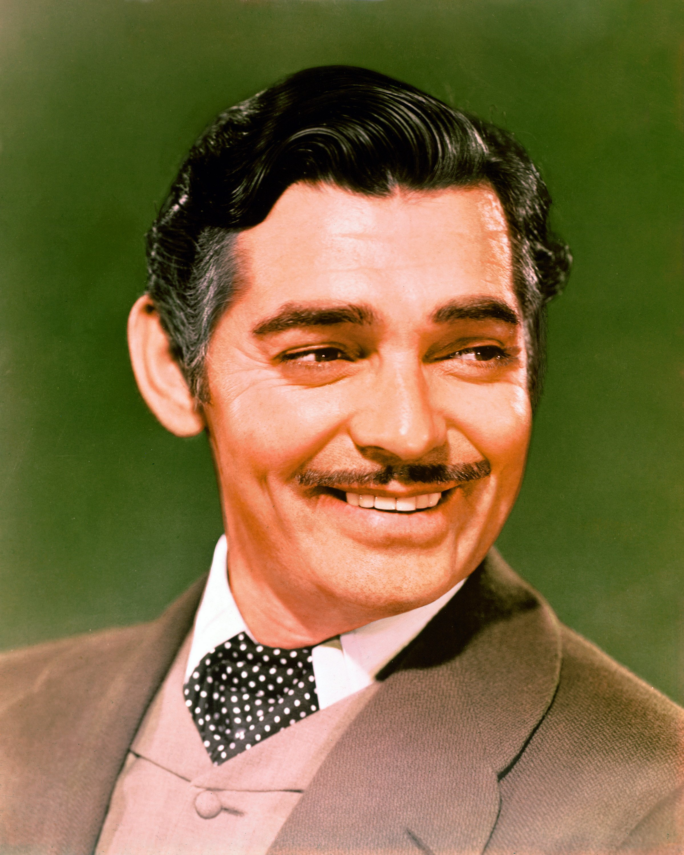 Headshot of Clark Gable (1901–1960), US actor, smiling in a publicity portrait issued for the film, 'Gone With The Wind', USA, 1939. The 1939 drama, directed by Victor Fleming (1889–1949), starred Gable as 'Rhett Butler'. | Source: Getty Images