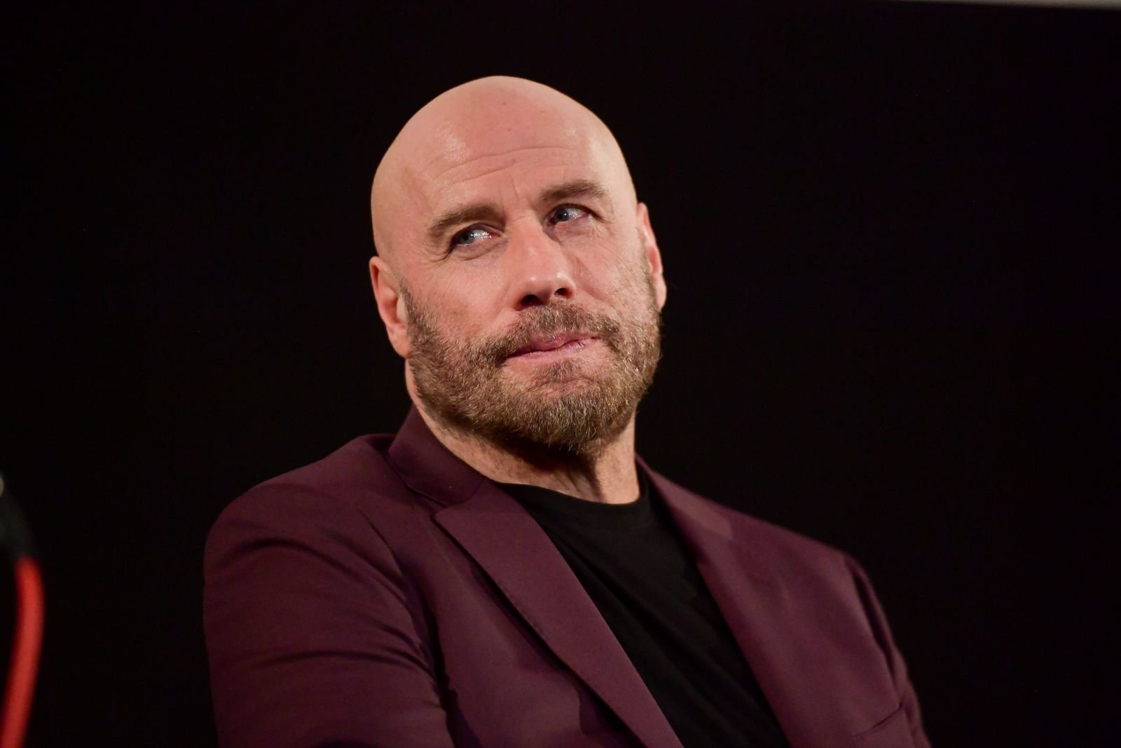 """John Travolta speaks onstage at the premiere of Quiver Distribution's """"The Fanatic"""" on August 22, 2019   Photo: Getty Images"""