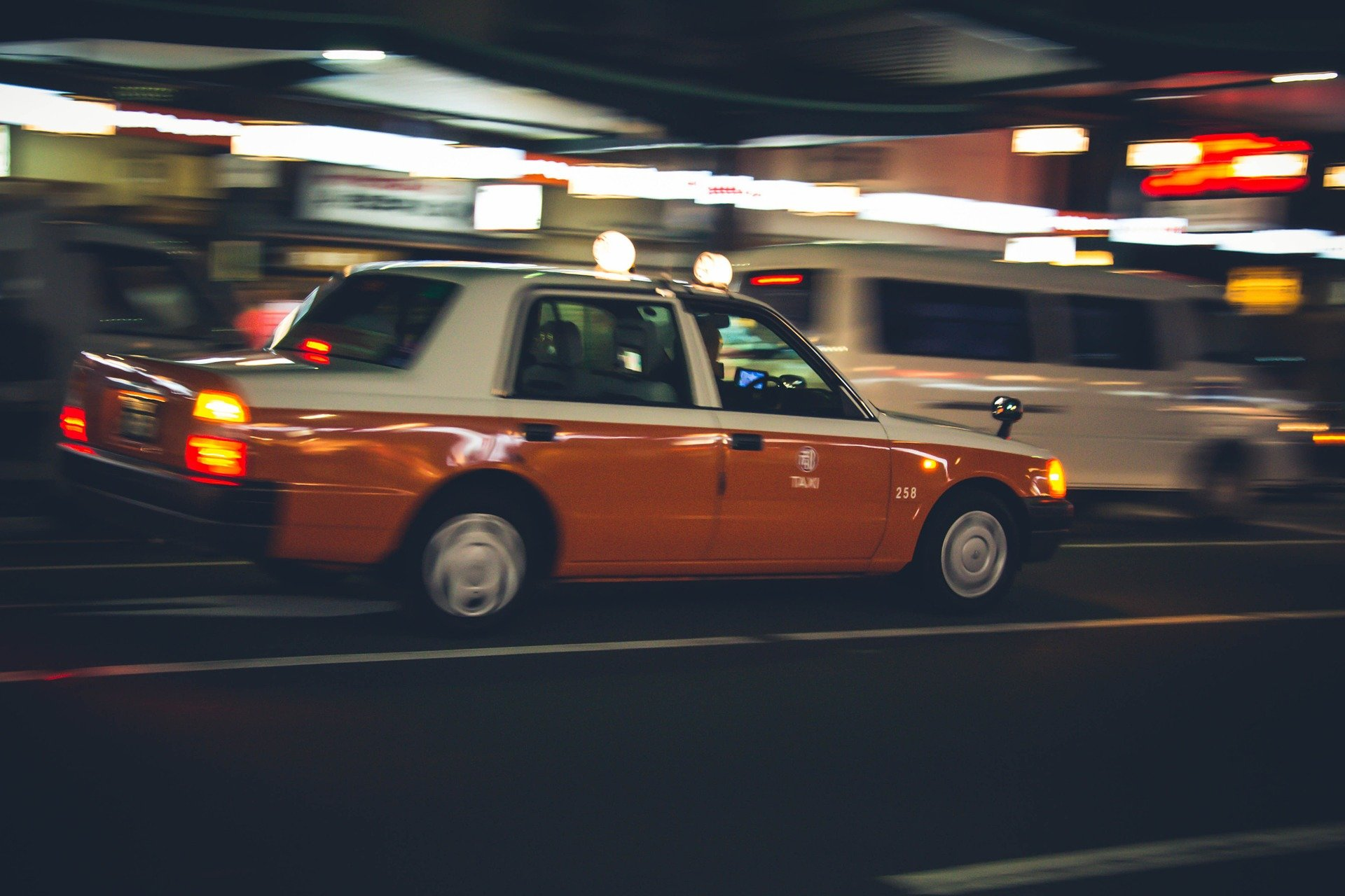 A taxi driving fast through traffic.   Source: Pixabay.