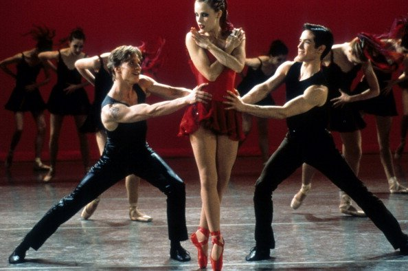 """Ethan Stiefel, Amanda Schull and Sascha Radetsky dance on stage in a scene from the film """"Center Stage,"""" 2000.   Photo: Getty Images"""